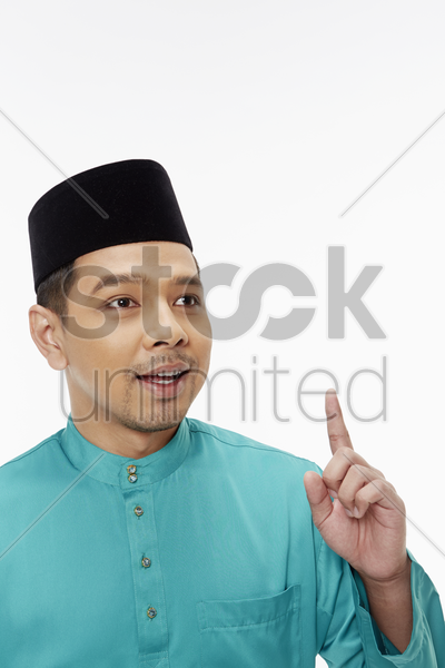 man in traditional clothing with a solution stock photo