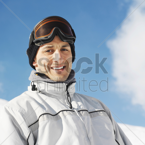 man in warm clothing and ski goggles stock photo