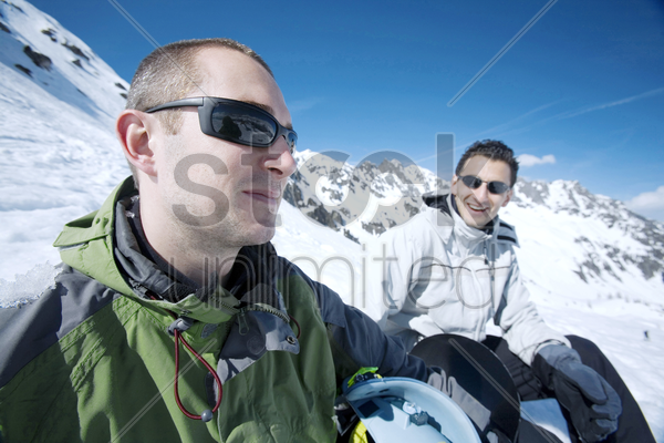 man in warm clothing and sunglasses stock photo