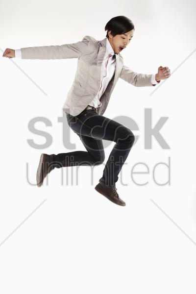 man jumping and posing, mid air stock photo