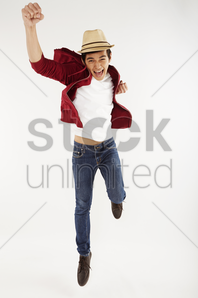 man jumping mid air, posing stock photo