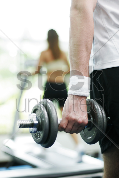 man lifting a dumbbell stock photo