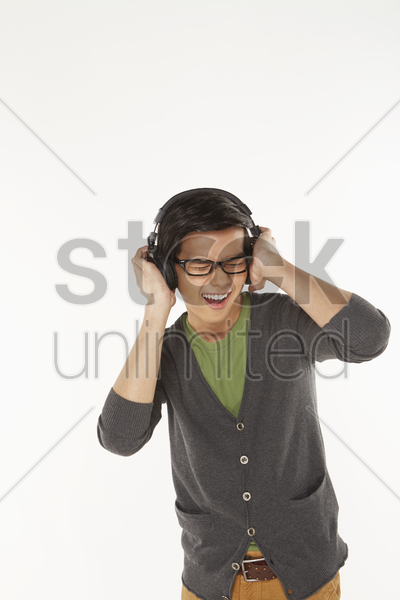 man listening to music on the headphone stock photo