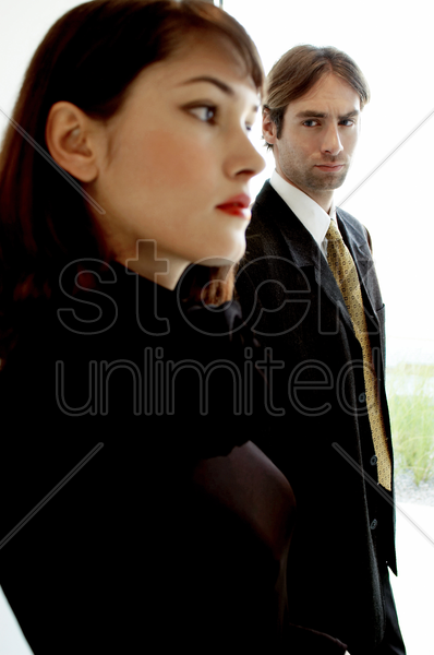 man looking at a woman stock photo