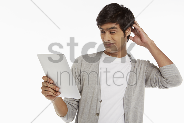 man looking at digital tablet stock photo