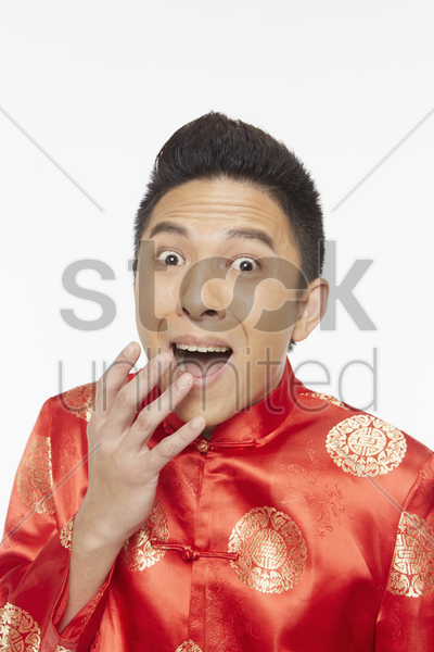 man looking very shocked stock photo