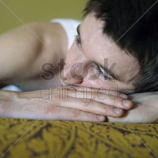 man lying down daydreaming stock photo