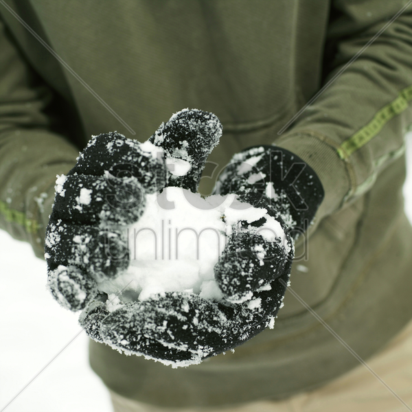 man making a snowball stock photo