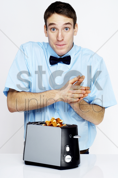 man making waffles with toaster stock photo