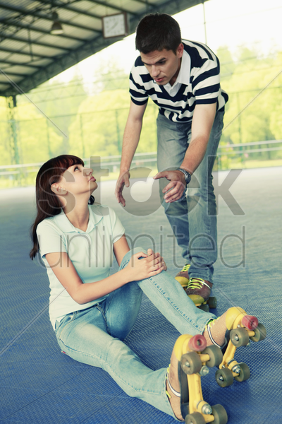 man offering to help woman up stock photo