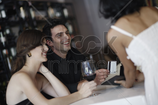 man paying the bill with credit card stock photo