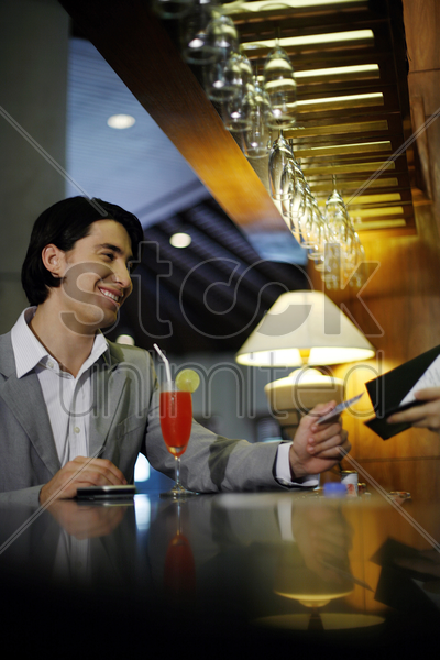 man paying with credit card stock photo