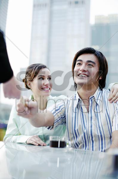 man paying with his credit card stock photo