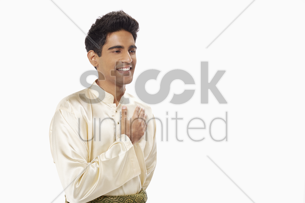 man placing hand on chest, showing greeting gesture stock photo