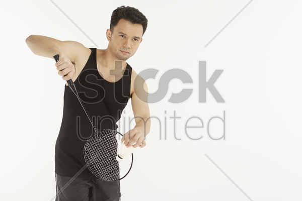 man playing badminton, serving stock photo