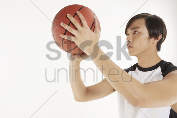 man playing basketball stock photo