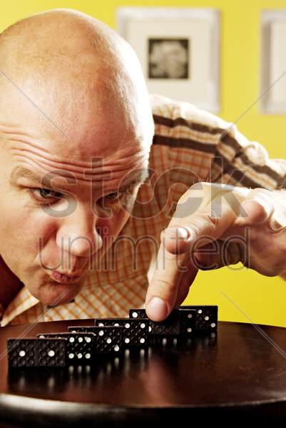 man playing dominos stock photo
