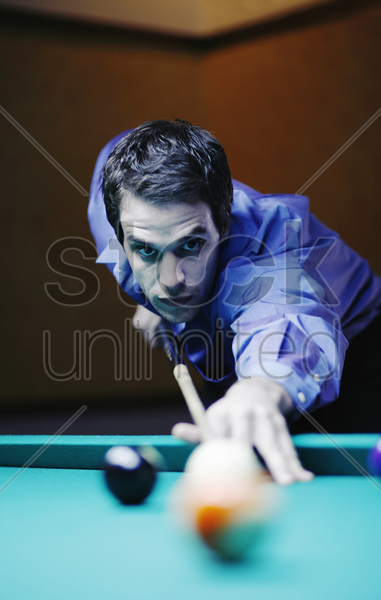 man playing snooker stock photo