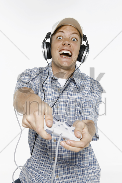 man playing video games with controller in his hands stock photo