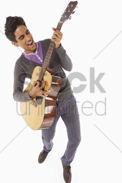 man playing with a guitar stock photo
