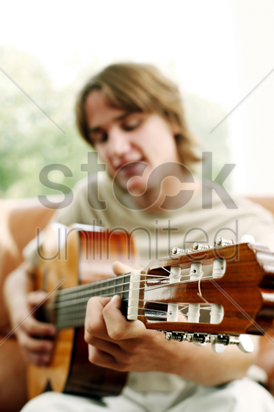 man playing with guitar stock photo