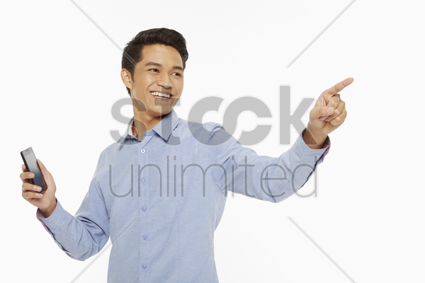 man pointing to the left stock photo