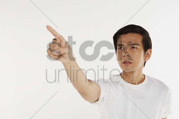 man pointing to the right, frowning stock photo