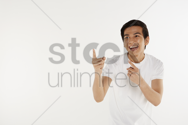 man pointing to the right, smiling stock photo
