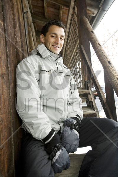 man posing at the chalet stock photo