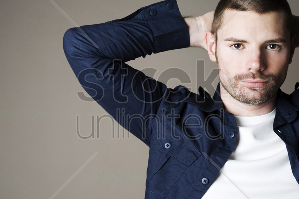 man posing for the camera stock photo