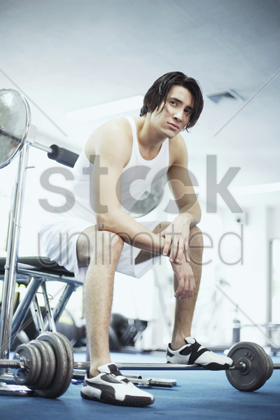 man posing in the gymnasium stock photo