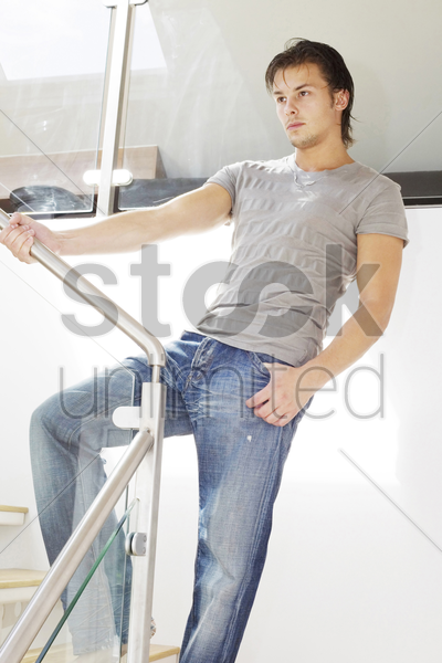 man posing on the staircase stock photo