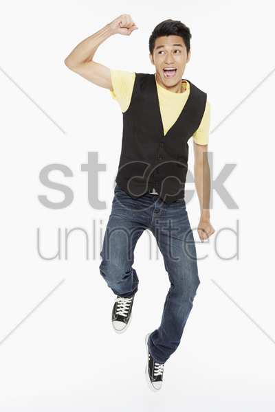 man posing while jumping mid air stock photo