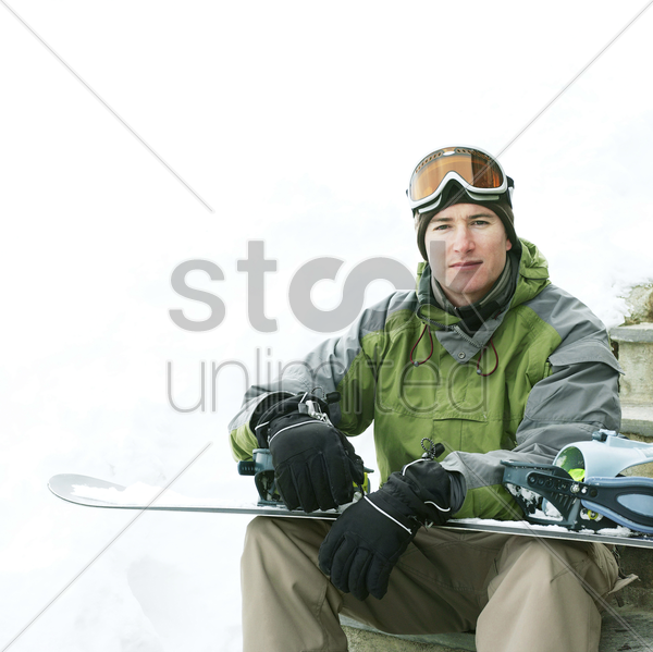 man posing with his snowboard stock photo