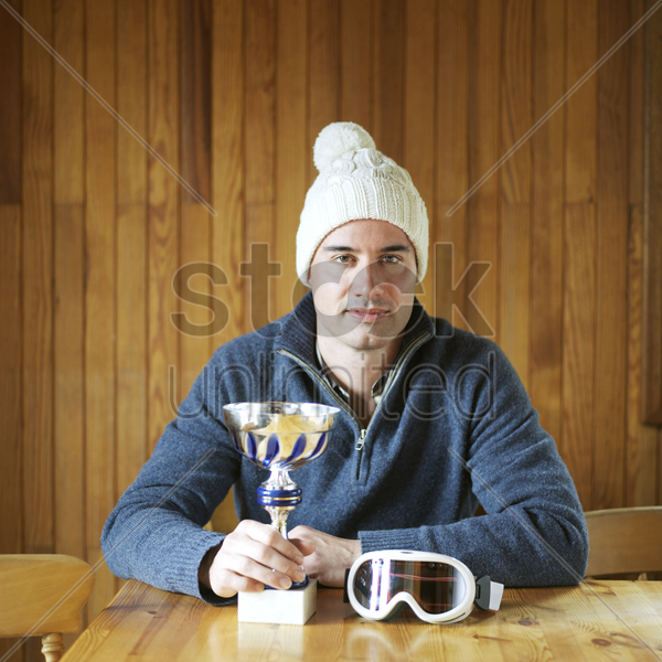 man posing with his trophy stock photo