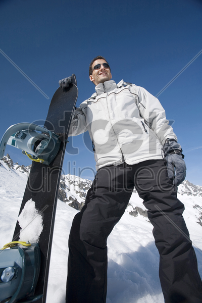 man posing with snowboard stock photo