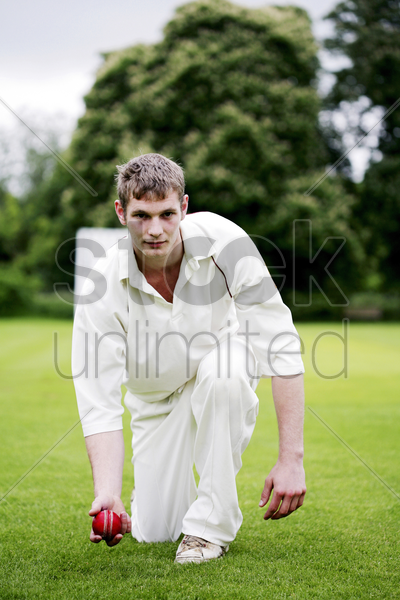 man preparing to throw a cricket ball stock photo