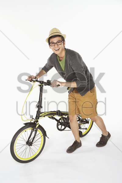 man pushing a bicycle stock photo