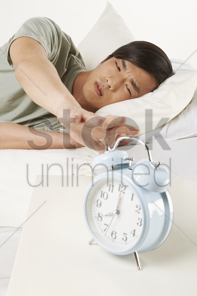 man reaching out for clock stock photo