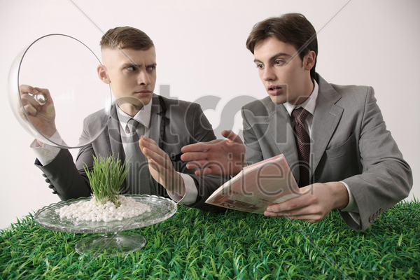 man refuse to sell grass seedlings to another man stock photo