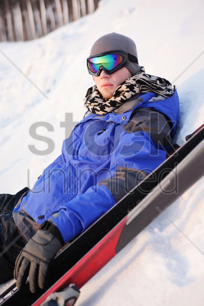 man resting after skiing stock photo