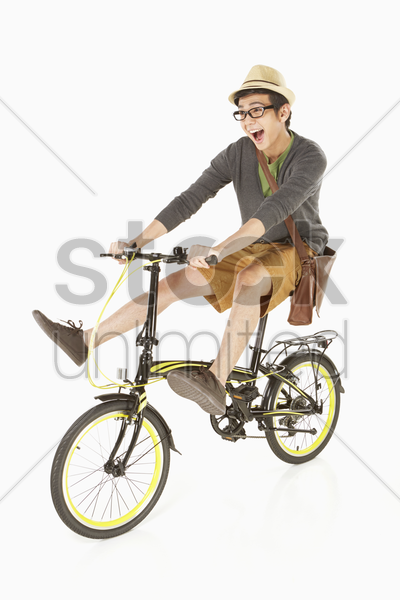 man riding on a bicycle stock photo