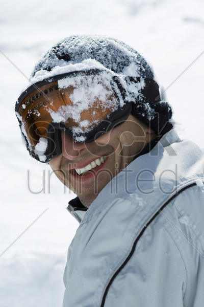 man's head covered by snow stock photo