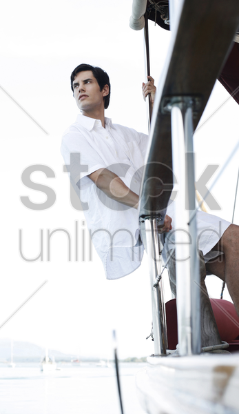 man sailing on yacht stock photo
