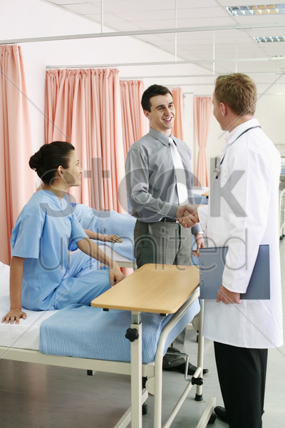 man shaking doctor's hand stock photo