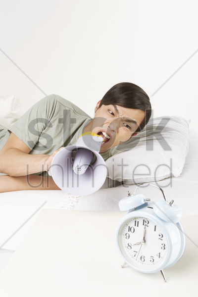 man shouting into megaphone stock photo