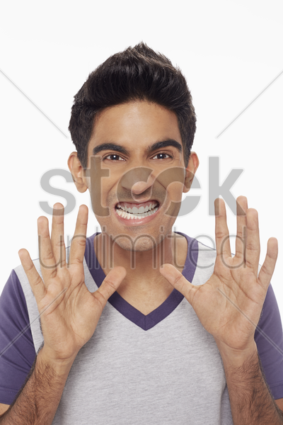 man showing a scary gesture stock photo