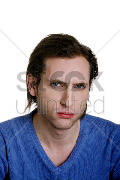 man showing angry face stock photo