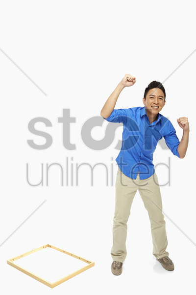 man showing hand gesture, cheering stock photo