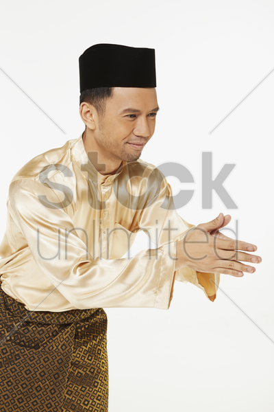 man showing hand greeting gesture stock photo
